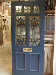 a georgous stained glass front door glazed with
