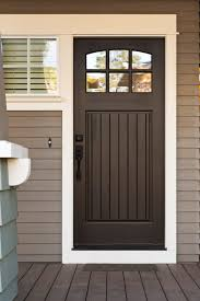 this black door is highlighted by white trim on a neutral grey toned home simple