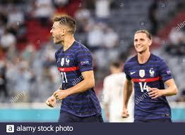 Monaco, Germania. 15 giugno 2021. Lucas Hernandez (L) della Francia celebra  il proprio obiettivo della Germania durante la partita del Campionato UEFA  Euro 2020 Gruppo F tra Francia e Germania a Monaco