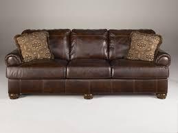 ashley furniture axiom walnut sofa to enlarge