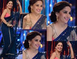 this is what madhuri dixit has done here in this look of hers in a blue dress madhuri has paired her smokey eyes with a light pink lipstick looks good for