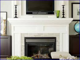 fireplace mantel decor with tv above image and kitchen