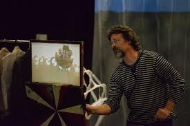 Designer Doug Hammett '87 manipulating shadow puppets for Big ...