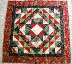 I Quilt Scarlet and Gray: Christmas Quilt Show entry & Cottonpickers Quilt Shop has the full size version of this quilt. I decided  to downsize the quilt to 3