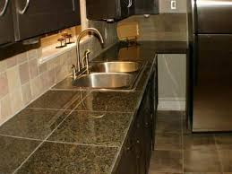 Amazing Kitchen Design With Undermount Sink And Brass Faucet And Ceramic  Tile Countertops