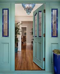 blue front door with stained glass windows