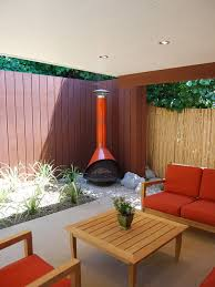 Minimalist patio photo in Los Angeles with a fire pit