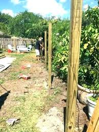 installing a wood fence installing wood fence posts without concrete setting wooden post calculator how to