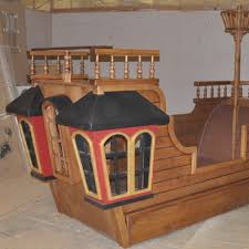 contempo furniture for kid bedroom design and decoration using decorative light brown wood pirate ship boat shaped bed frame