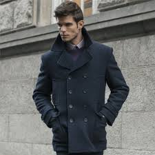 i think i d want a coat with a slight taper from the shoulders to the waist but without looking like it belongs in a military uniform so perhaps something