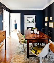 View in gallery. Painting all four walls of your dining room navy blue ...