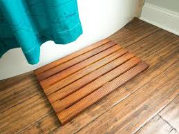 wooden bathroom mat white bathroom with hard wood flooring containing blue curtain with wooden bath mat