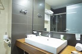 a renovated bathroom with new mirror