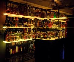 huge tequila collection floating wall shelves