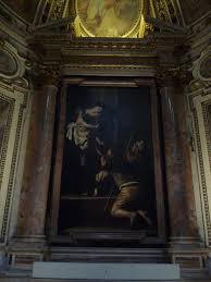 caravaggio s madonna dei pellegrini is in the church of sant agostino