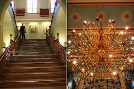 grand staircase and chandelier in bhau daji lad