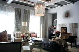 african interior design black leather sofa and white armchair plus double round dining table over covered