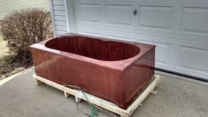 here s a mahogany tub that is designed to fit into a traditional 60 tub space