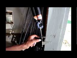 how to adjust garage door springsHow to change the side spring on the garage door  YouTube