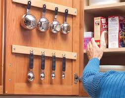33. Use the inside of your cabinet doors to store smaller utensils. 34  Insanely Smart DIY Kitchen Storage Ideas