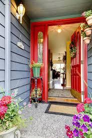 Bright Red Open Front Door To Blue House With Hardwood Floor Int