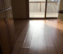 laminate floor damaged from water pipe bursting under the sink