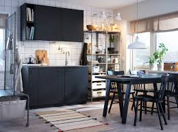 ikea home designs. monochrome kitchen with black cabinets and table metal open shelving. ikea home designs