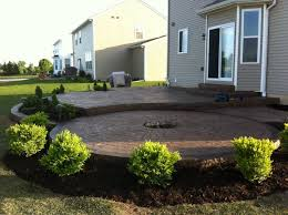 Concrete patio with square fire pit Square Fit Premier Surgeon Stamped Concrete Patio Two Levels With Fire Pit Ring