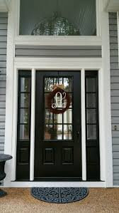 model 440 signet fibergl front entry door coal black with aged bronze finish hardware installed by the richmond