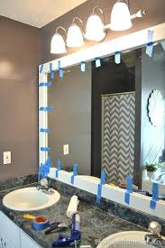 frame around bathroom mirror use tape to hold frame while it dries diy bathroom mirror frame