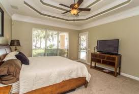1 tag Contemporary Master Bedroom with High ceiling, flush light, Ceiling  fan, Carpet, Crown