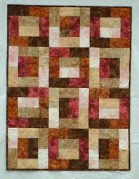 Batik Popsicle Sticks Quilt | ✂----A Stitch In Time ... & a great pattern for batik fabrics. Love the movement created by using VALUE  in this quilt. Adamdwight.com