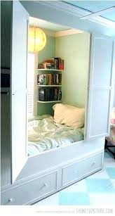bed with closet underneath loft walk in under bath and beyond be