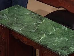 faux green marble finish aplied to old tabletop