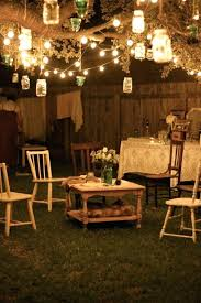 outdoor lighting ideas for patios. Hanging Outdoor Lights Best Backyard String Ideas On Patio Brick Garden Party At Night Lanterns Hang From Tree Branches And Rustic Lighting For Patios G