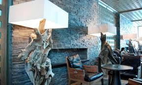 indoor stone fireplace. charcoal rock panels for interior stacked stone fireplace in commercial lobby airport dubai indoor