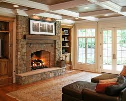 Elegant living room photo in Other with a brick fireplace