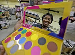 raynell steward at the crayon case cosmetics is reflected in a box of crayons shadow palette on thursday november 29 2018 photo by michael democker