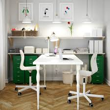 a white home office with white linnmon table for two vgsbergsporren swivel chairs anew office ikea storage