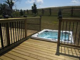 affordable hot tub above ground pools can be combined with wooden fence it also has small