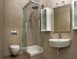 small shower stall with corner sliding glass door feat wall mounted bathroom sink and frameless mirror