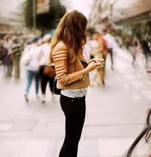 a puffy brown leather jacket adds shape and dimension to this edgy street ensemble