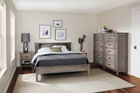 Amusing Guest Room Idea With Distressed Wood Furnishings And Dark Gray  Bedding
