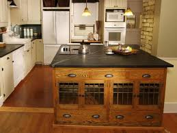 black marble countertop vintage kitchen island with white cabinet image