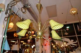 what you will note on first examining this french 1950 s light fixture is the quality and