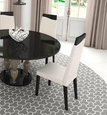 modern round glass top dining table with a base in high gloss finish