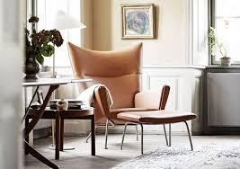 view in gallery wegner wing chair in home of knud erik hansen