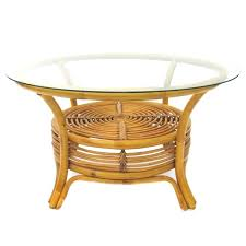 round rattan coffee table with glass top and woven spiral shelf below port royal luxe brown
