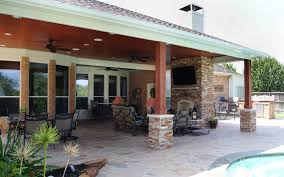 cypress patio cover with fireplace kitchen