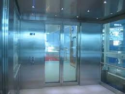 humongous kone glass elevator doors at